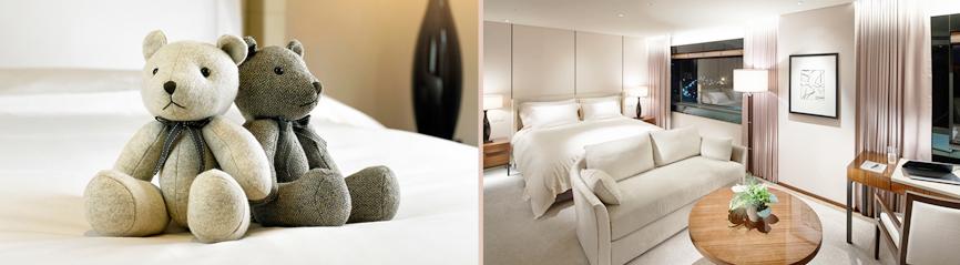 첫번째 이미지는 포근한 느낌의 객실 침대 위에 신라 베어 인형 두 개가 놓여있는 이미지이다. 두번째 이미지는 실내 체련장의 낮 전경 이미지로, 햇살이 비추는 통창 유리 앞에 러닝 머신이 여러 대 준비되어 있다.