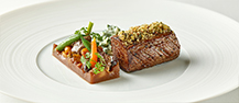 Char-grilled French Rack of Lamb with Provencal, Carrots, Beans, Seasonal Vegetables and Épinard a la Cream