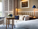 <p>The Premier room features the atmosphere of a luxurious summer house guest room.</p>